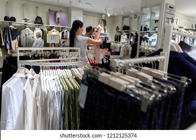 Customers choose SPAIN, Calella - SEPTEMBER 15, 2016: clothes on the racks in a large store in Calella, Spain.