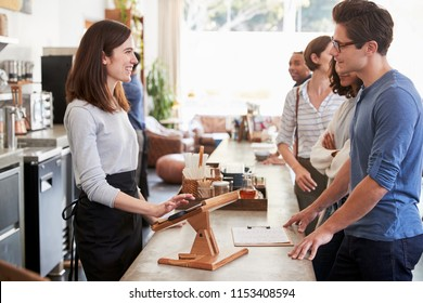 Customers at a coffee shop queuing to order and pay