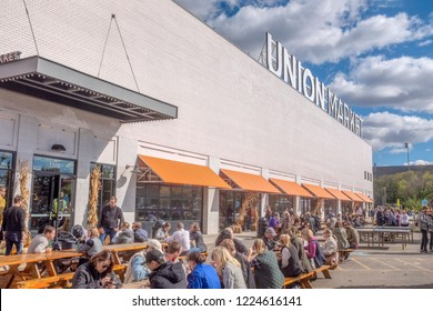 Customers eat their food at outdoor picnic tables at Union Market, Washington, DC, November 3, 2018.
