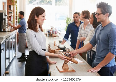 Customers queuing to order and pay at a coffee shop