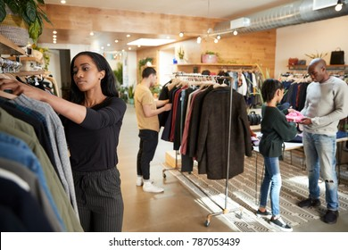 Customers and staff in a busy clothes shop