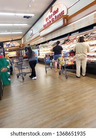 Customers at the supermarket looking for meat on the shelves in-stater Bros .indoor meat stand. Perris California.april 7,2019