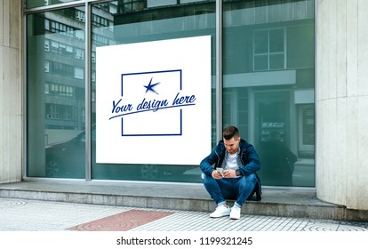 Customizable poster in a shop window with a guy sitting on the curb looking at the mobile outdoors