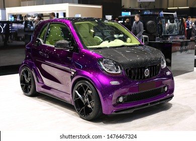 Customized shiny purple Smart for Two with black details by Mansory. This car was photographed in Geneva International Motor Show (GIMS) 2019. Small car with a lot of style!