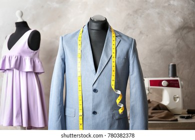 Custom-made suit on mannequin in atelier