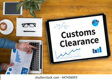 Customs Clearance Businessman working at office desk and using computer and objects, coffee, top view,