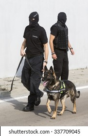 Customs officers and their dog are participating in a training for drugs detection in Sofia's airport. The dogs are trained to find drugs smuggled in the luggage.