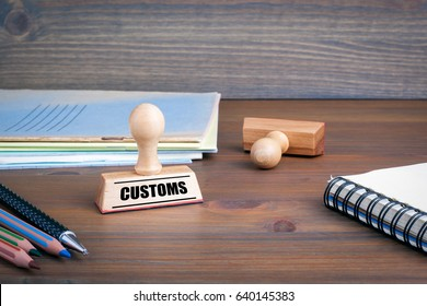 Customs. Rubber Stamp on desk in the Office