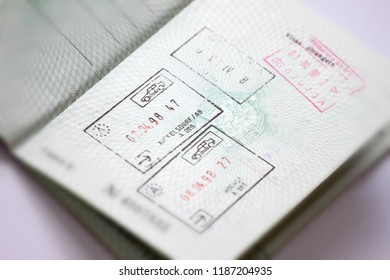 Customs stamps in international passport for traveling around the World. Document for traveling. Stamps and visas.