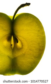 Cut apple through which the light passes, macro, close-up, isolated on a white background