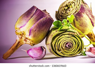 cut artichokes ready to cook with garlic and mint leaves