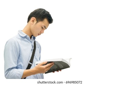 Cut Asian young student man holding book and reading on isolate,teenager boy reading