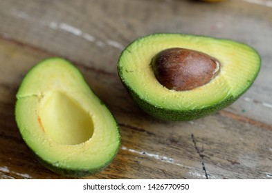 Cut avocado on a wooden background