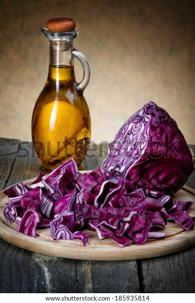 The cut cabbage and olive oil bottle on an old table