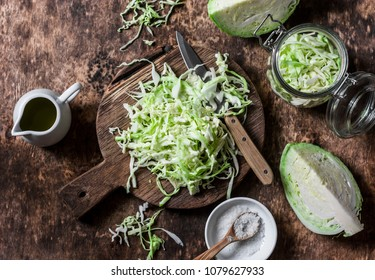 Cut cabbage on wooden chopping board on wooden background, top view. Vegetarian, slimming, diet food concept. Flat lay