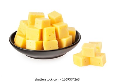 Cut of cheese in a black plate isolated on a white background