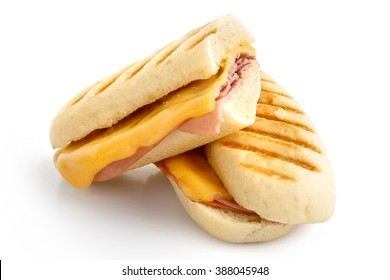 Cut cheese and ham toasted panini melt with grill marks. Isolated on white.