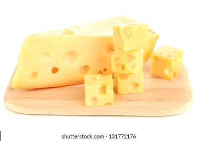 Cut cheese on wooden board isolated on white