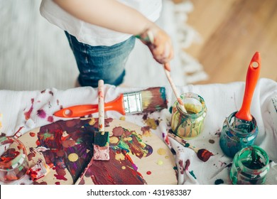 Cut child  painting in at her  home. Close up ...Selective focus and small depth of field.
