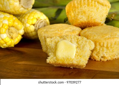cut corn muffin with a pat of butter and ingredients