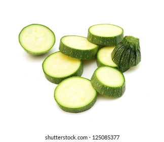 cut courgette or zucchini on a white background