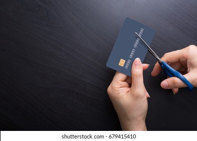 Cut credit card with scissors for stop to pay money protect crisis cost.