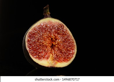 Cut figs on a black background. figs on black mirror
