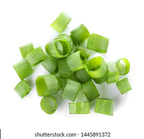 Cut fresh green onion on white background, top view