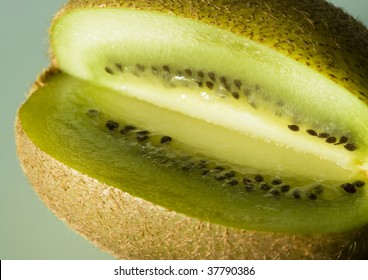 A cut fresh kiwi is placed on the table.