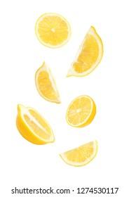 Cut fresh lemons falling against white background