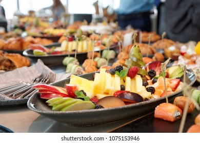 Cut fruits and another dishes on catering table, hotel breakfast