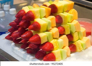 Cut Fruits on Sticks with Strawberries Pineapples Honeydews Cantelopes and Melons in Display Case