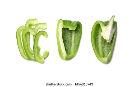 Cut green bell pepper on white background, top view