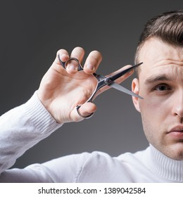 Cut hair. Man strict face hold scissors. Barber glossy hairstyle hold steel scissors. Create your style. Macho confident barber cut hair. Barbershop service concept. Professional barber equipment.