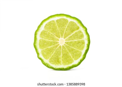 Cut in half of Fresh Bergamot fruits isolated on white background with clipping path.