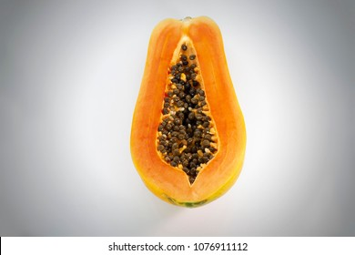 Cut half of papaya as same as female sexual organ