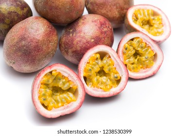 Cut half of passion fruit isolated on white background, sour fruit, fruit background, healthy food