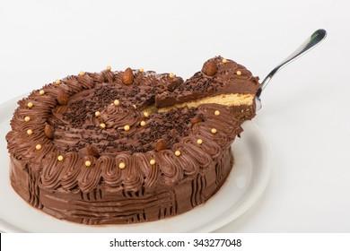 Cut homemade chocolate cake served on a plate
