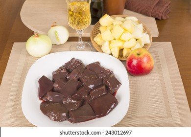 cut into pieces of raw liver goats and fresh apples