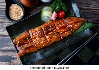 Cut Japanese eel grilled or Unagi ibaraki set on plate in Japanese style with studio lighting