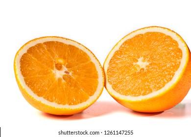 Cut juicy orange isolated on white background.
