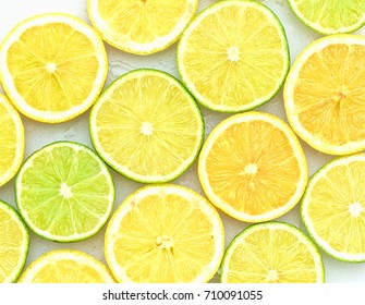 Cut lemons and limes abstract