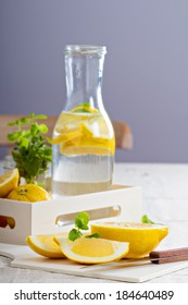 Cut lemons on a cutting board and lemonade