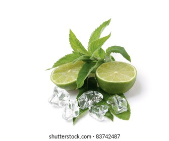 Cut lime in ice isolated on white background