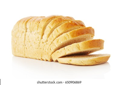 The cut loaf of wheat bread with reflection isolated on white