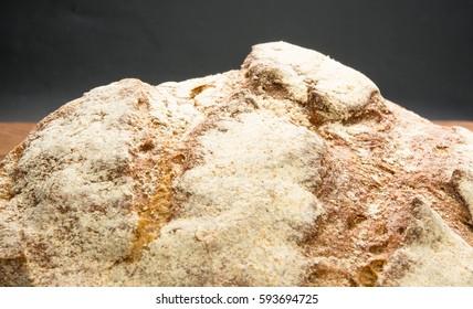cut malt bread handmade on wooden background