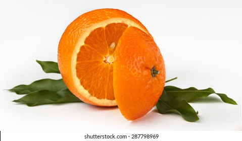 cut the mandarin with leaves on white background