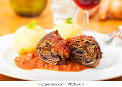 cut meat roulade on a plate
