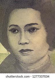 Cut Nyak Meutia portrait on Indonesia 1000 rupiah. Indonesian national heroine.