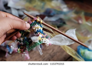 Cut nylon bag into yarn and woman hand knit to basket, good idea to recycle nylon bag to reduce environmental pollution